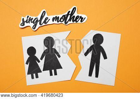 Being Single Mother After Divorce Concept. Paper Cutouts Demonstrating Broken Family On Orange Backg