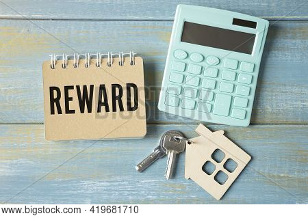 Reward Text On White Notepad Paper On Light Background