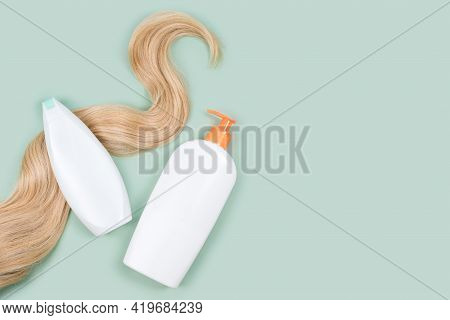 Shampoo Wrapped In Lock Of Curly Blonde Hair And Conditioner Bottle Mockups On Mint Background, Top