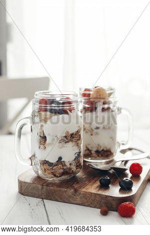 A Healthy, Dietary Breakfast Or Snack Of Granola Or Oatmeal Muesli With Yoghurt And Fresh Wild Berri