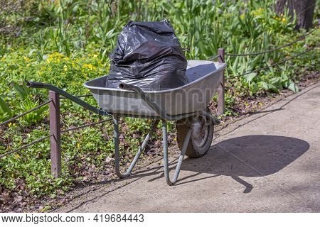 Iron Wheel Barrow For Moving Of Building Materials In The Garden And In The Backyard
