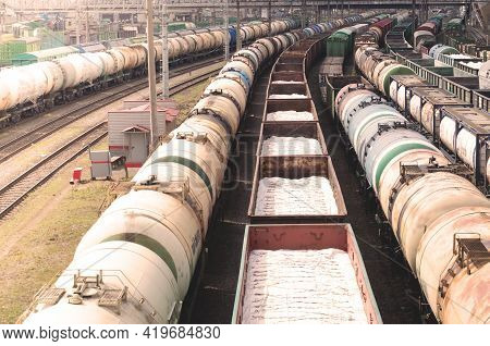 Wagons With Goods On Railroad. Heavy Industry. Industrial Landscape With Train, Railway Platfform At