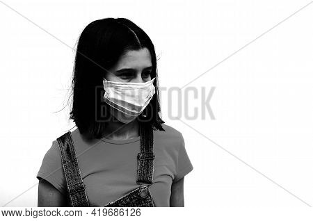 Bw Portrait Of A Girl Wearing A Surgical Mask To Protect Herself From The Corona Virus
