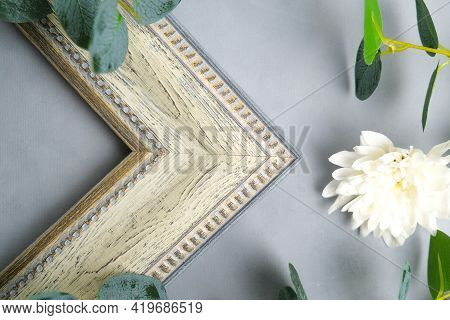 Corner Of Decorative Empty Picture Frame And Flowers. Sample Of Photo Frame On Floral Background. Ho