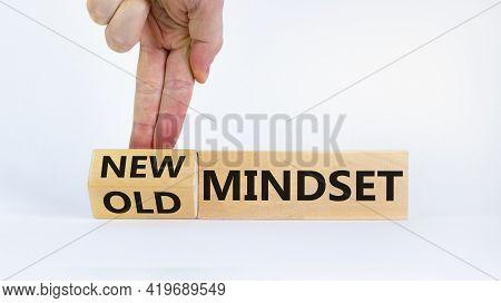 New Vs Old Mindset Symbol. Businessman Turns The Wooden Block And Changes Words 'old Mindset' To 'ne