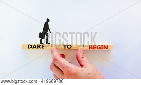 Dare To Begin Symbol. Wooden Blocks With Words 'dare To Begin'. Beautiful White Background, Business