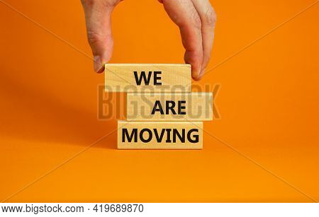 We Are Moving Symbol. Wooden Blocks With Words 'we Are Moving'. Beautiful Orange Background, Busines