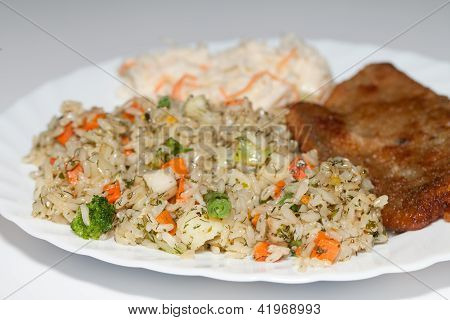Brown rice with fisch and vegetable.