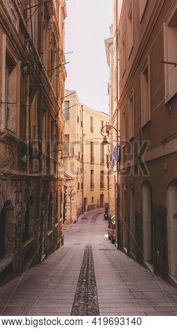 Narrow street in the city of Cagliari, Italy