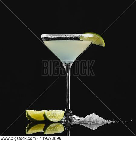 Tequila Cocktail. Alcoholic Drink. Booze In Tall Glass With Slice Of Lime And Salt. Object Isolated