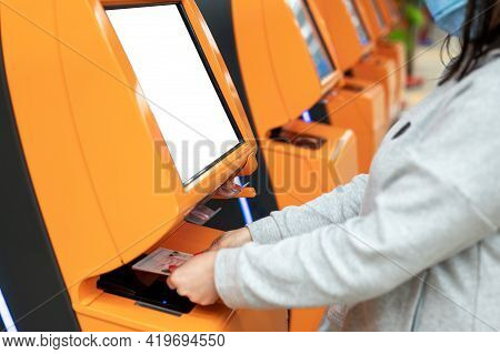 Woman Scans Her Passport At The Airline Counter For Self Check-in At The Airport. Woman Travelling B