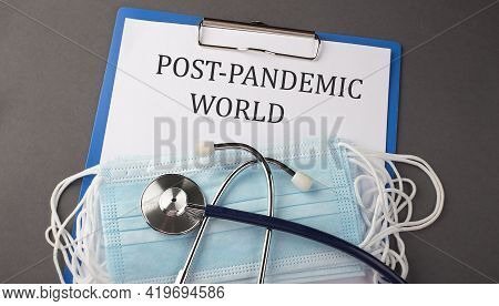 Folder With Paper Text Post Pandemic World , On A Table With A Stethoscope And Medical Masks, Medica