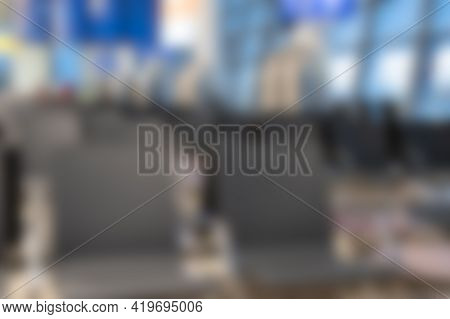Blurred Backgound Of Airport Waiting Area. Out Of Focus Of Rows Of Chairs In Airport. Defocused View