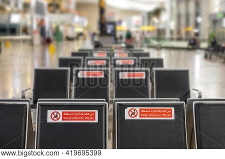 Empty Rows Of Seats In The Airport Lounge During The Coronavirus Covid-19 Pandemic. Close-up Warning