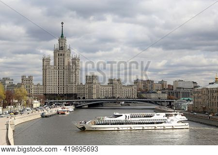 Moscow, Russia - April 2021: View Of The Moscow River And Tourist Boat On Cloudy Sky Background. Sce