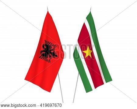 National Fabric Flags Of Republic Of Albania And Suriname Isolated On White Background. 3d Rendering