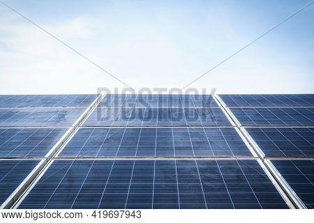 Old Solar Panels Against Blue Sky Background, Arrangement Of Solar Energy Production Plant Or Solar
