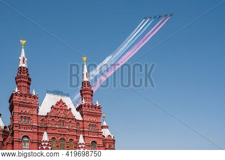 Victory Parade On Victory Day On May 9. Russian Military Aircraft Fly Over Red Square. The Aerobatic