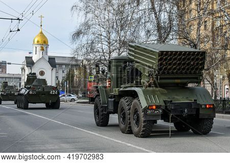 Car Of Russian Army Against Background Of White Chapel. Military Equipment Drives Through The Empty