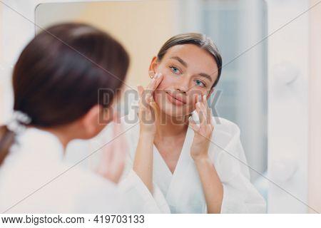 Young Caucasian Woman Doing Facebuilding Yoga Facial Gymnastics Self Lymph Facelift Massage At Home