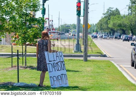 New Orleans, La - May 6: Lone Protester Holds Anti Biden Sign On Median While Awaiting Presidential