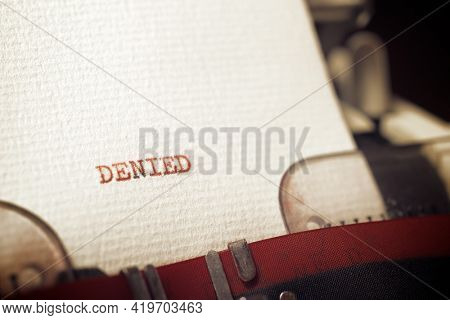 The word denied written with a typewriter.