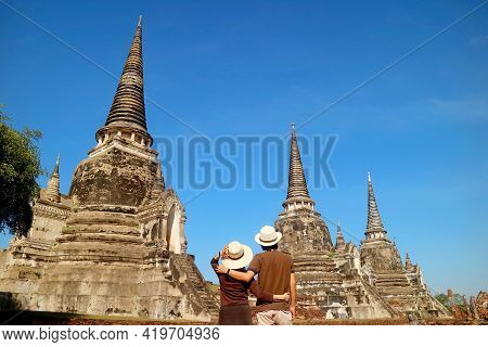 Couple Impressed By The Incredible Historic Pagoda Ruins Of Wat Phra Si Sanphet In Ayutthaya Histori