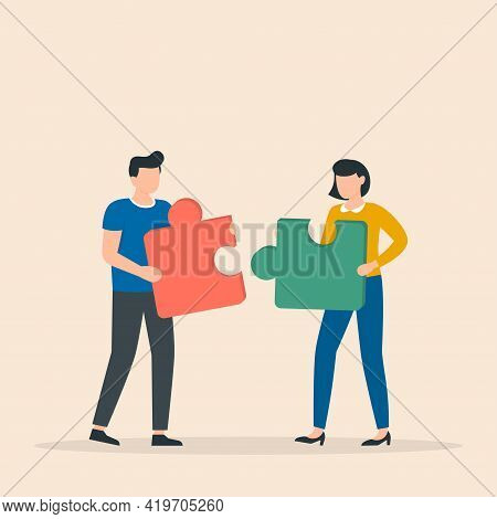 Working Together, Cooperation, Partnership. Man And Woman With Puzzle Pieces Working Together. Busin