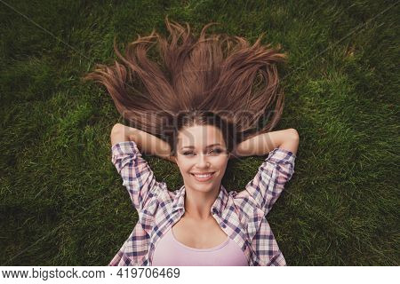 Photo Portrait Of Girl Chilling Relaxing Laying On Grass Smiling In Checkered Shirt After Working Da