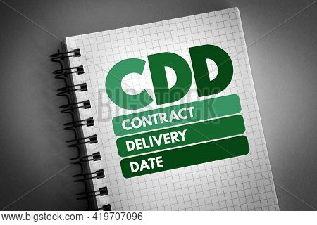 Cdd - Contract Delivery Date Acronym On Notepad, Business Concept Background