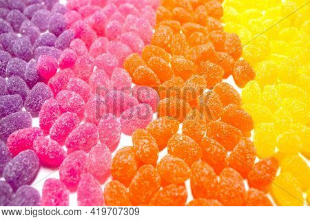 Purple Pink Orange And Yellow Sugar Sprinkled Covered Yellow Fruit Candy Jelly Sweets