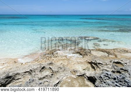 The Scenic View Of Half Moon Cay Rocky Shore And Turquoise Color Transparent Waters (bahamas).
