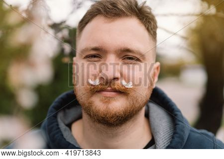 Man With White Flowers In Mustache. Breathe Free