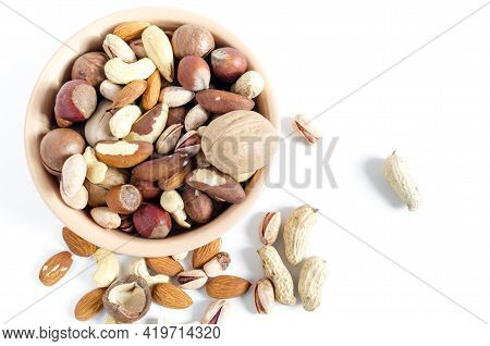 Nuts In Ceramic Dishes And Nuts Scattered On A White Background Top View Assorted Nuts