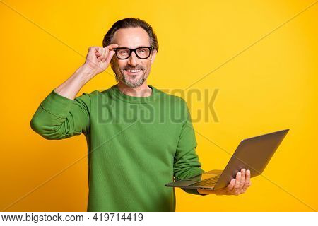 Photo Of Guy Hold Laptop Beaming Smile Look Camera Wear Eyeglasses Green Pullover Isolated Yellow Co