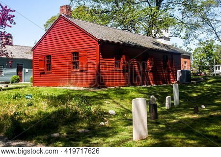 NORWALK, CONNECTICUT - MAY 6, 2021: Norwalk`s downtown district Old school house c1826 at Mill Hill with burying ground