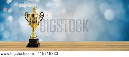 1st Champion Award, The Best Prize And Winner Concept, Championship Cup Or Winner Trophy On Wood Tab