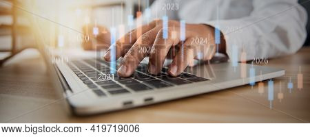 Business Stock Market Graph With Hand Of Business Man  And Financial Investor Typing On Laptop, Fina