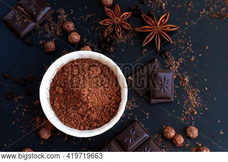 Chocolate Chunks, Cocoa Powder And Spice On Dark Slate Table, Cooking Ingredients Top View