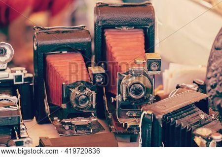 Barcelona - Spain. June 27, 2019: Retro Photo Cameras In The Vintage Market (vintage Photo Effect)