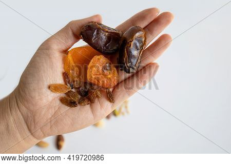 Famale Hand Holding Different Useful Dried Fruits