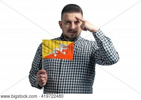 White Guy Holding A Flag Of Butane And A Finger Touches The Temple On The Head Isolated On A White B