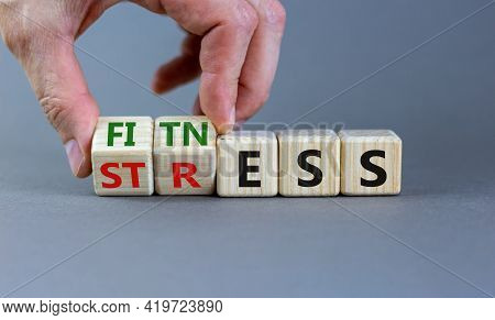 Fitness Vs Stress Symbol. Doctor Turns Cubes And Changes The Word 'stress' To 'fitness'. Beautiful G