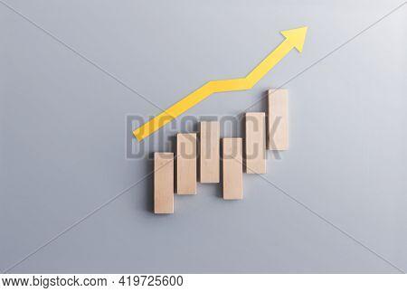 Financial Growth Recovery Concept, Business Chart Wood Blocks With Arrow Moving Upwards