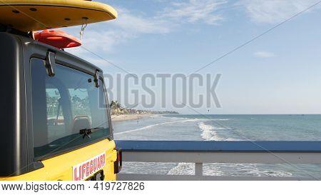 Yellow Lifeguard Car, San Clemente Beach Pier, California Usa. Coastline Rescue Life Guard Pick Up T