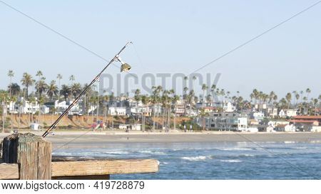 Saltwater Angling, Wooden Pier Boardwalk Railing, Fishing Accessory, Tackle Or Gear. Oceanside Calif