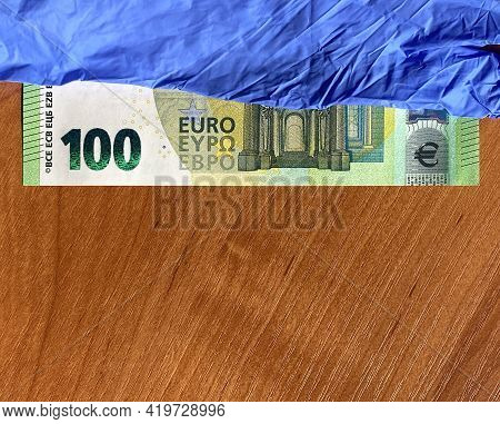 Blue Latex Gloves And 100 Euro Bill. For The Cashier Or Seller, Sale Of Latex Gloves. Flat Lay.