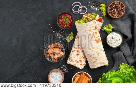 Shawarma With Vegetables, Salad And Chicken On A Black Background With Ingredients. Top View, Copy S