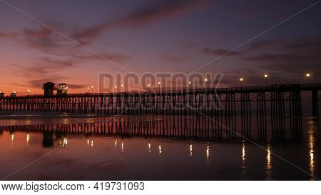 Pier Silhouette Oceanside California Usa. Pacific Ocean Tide Tropical Beach. Summertime Gloaming Atm