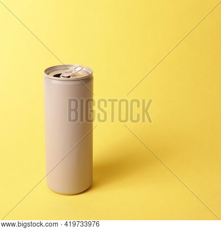 Gray grey can drink beverage juice on yellow background concept minimal aesthetic